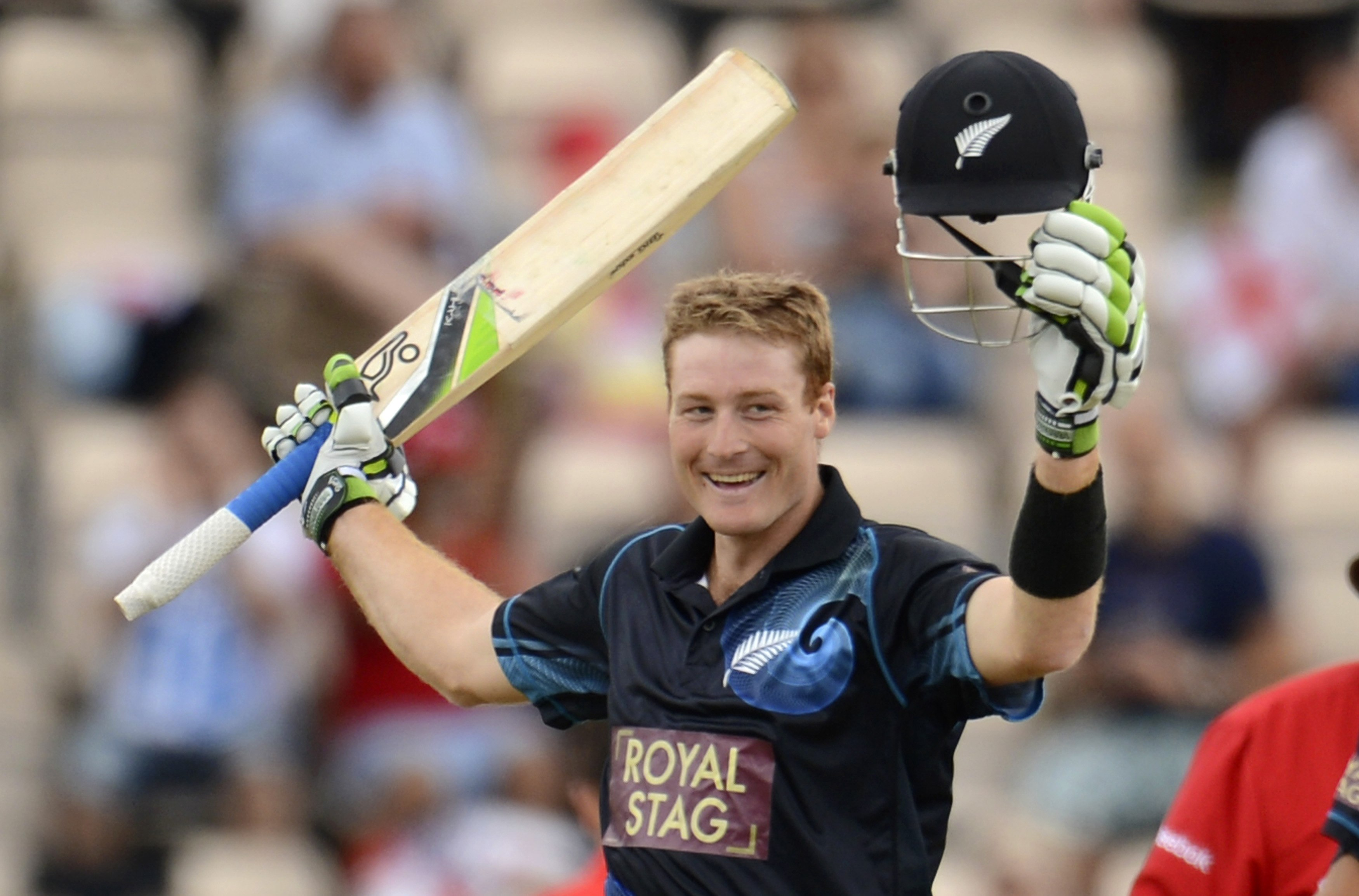 New Zealand's Guptill celebrates reaching his century during their second one-day international cricket match against England at the Ageas Bowl cricket ground in Southampton