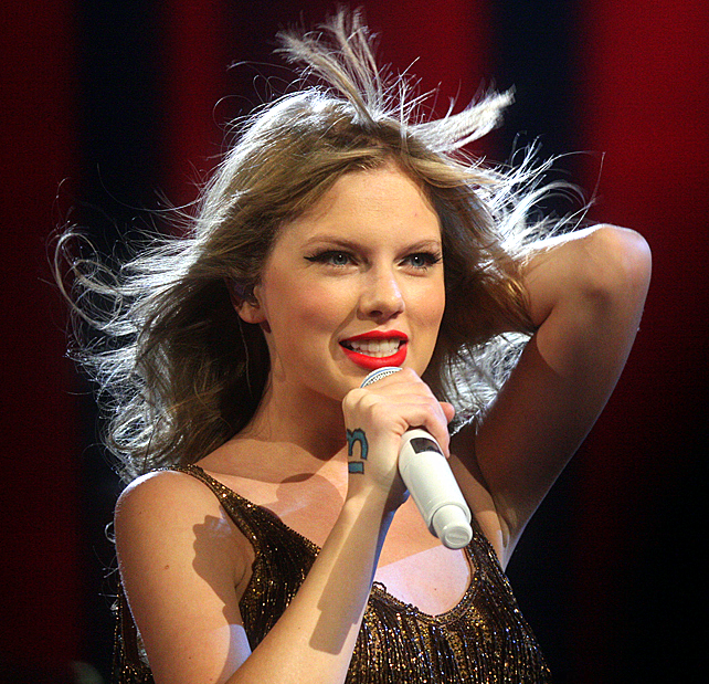 International Singer Taylor Swift Rocks & Brings Out Surprise