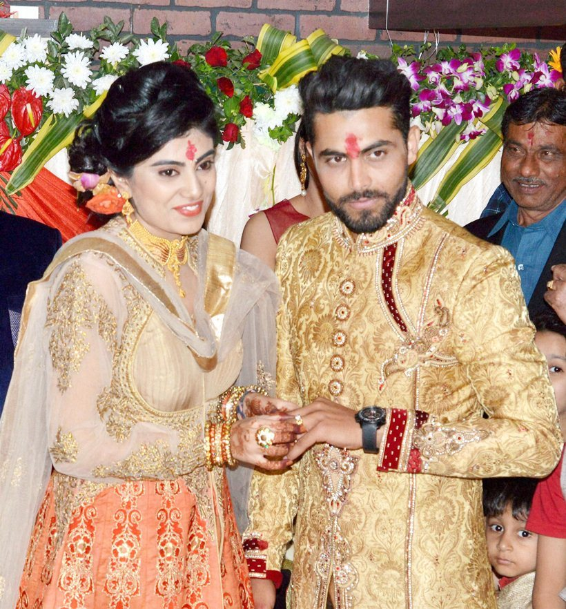 Rajkot: Cricketer Ravindra Jadeja exchanges rings with fiancée Rivaba Solanki at their engagement ceremony at a hotel in Rajkot on Friday. PTI Photo(PTI2_5_2016_000071B) *** Local Caption ***