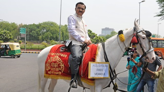 BJP MP rides on horse to Parliament as a protest against Delhi Odd-Even scheme