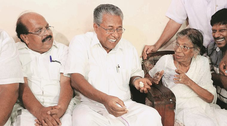 Alappuzha: CPI-M leader and Kerala chief minister-designate Pinarayi Vijayan sharing a light moment with veteran politician K. R. Gowri Amma on the occasion of his birthday , in Alappuzha on Tuesday. PTI Photo(PTI5_24_2016_000301B)