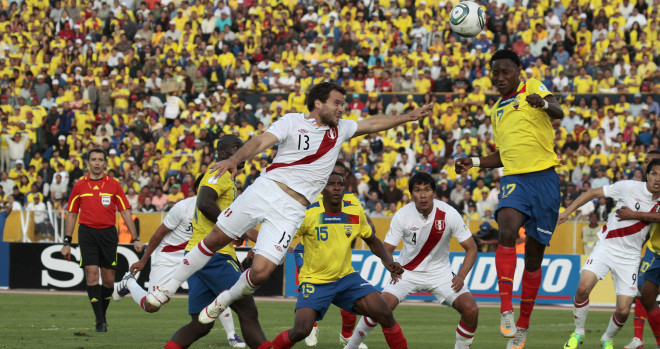 QUITO, ECUADOR- NOVEMBER 15: Joao Rojas, from Ecuador, fights for the ball with Renzo Revoredo Suazo, from Peru, during a match between Ecuador and Perú as part of the fourth round of the South American Qualifiers for FIFA World Cup Brazil 2014 at Atahualpa Stadium on November 15, 2011 in Quito,Ecuador. (Photo by Edu Leon/LatinContent/Getty Images)