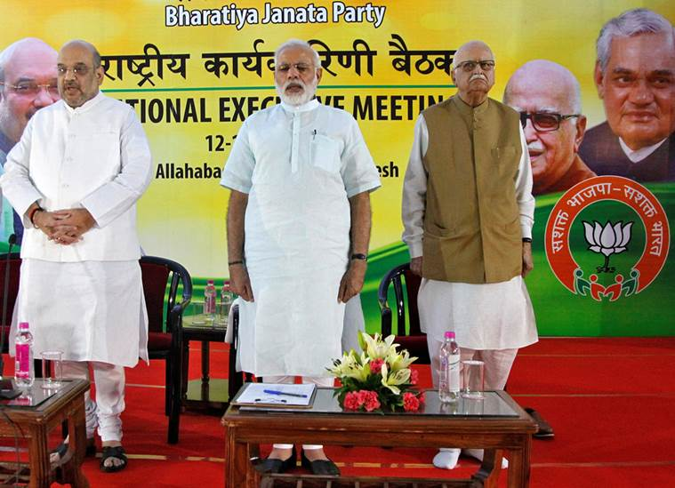 (L-R) Amit Shah, president of India's ruling Bharatiya Janata Party (BJP), Prime Minister Narendra Modi and L.K. Advani, a leader of BJP, sing a patriotic song during the party's national executive meeting in Allahabad, India, June 12, 2016. REUTERS/Jitendra Prakash