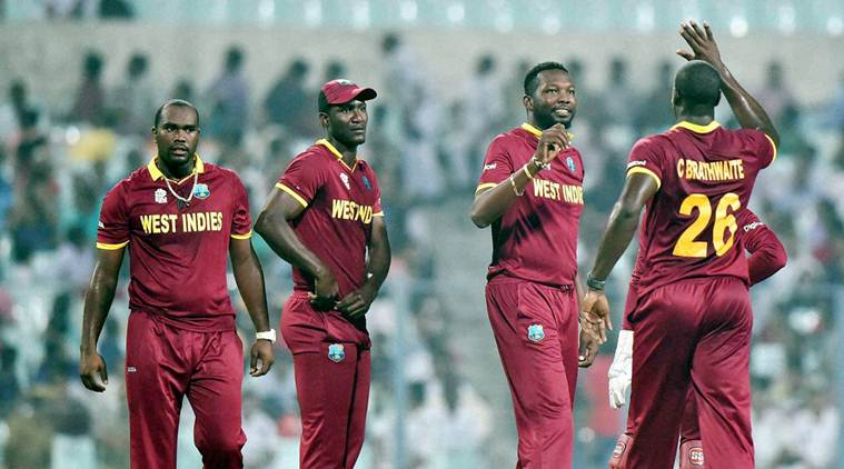 Kolkata: West Indies Captain Darren Sammy with other players celebrate after fall of an Indian wicket during their World Cup T20 warm up match at Eden Gardens in Kolkata on Thursday. PTI Photo by Ashok Bhaumik (PTI3_10_2016_000297A)