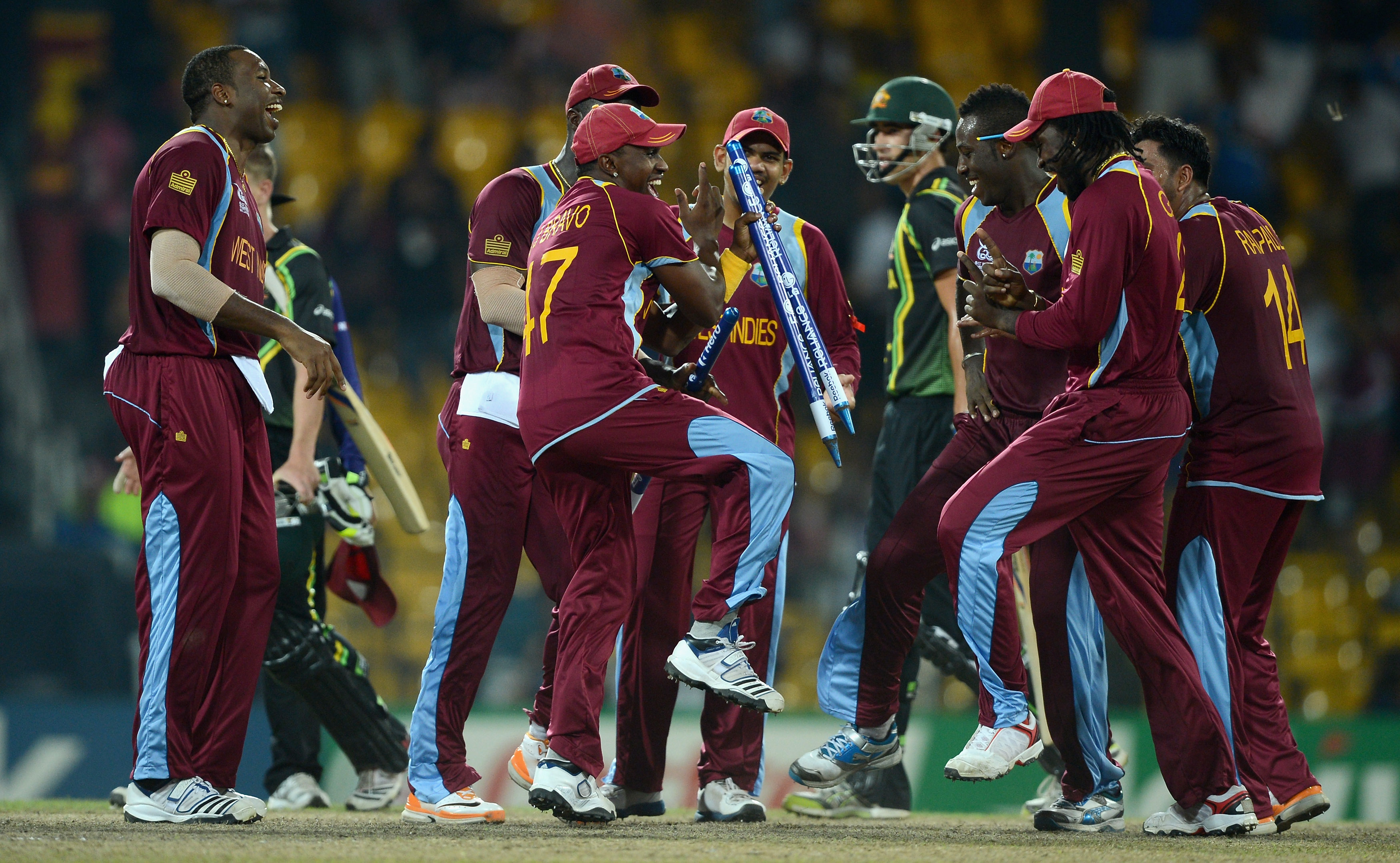COLOMBO, SRI LANKA - OCTOBER 05: West Indies dance in celebration after winning the ICC World Twenty20 2012 Semi Final between Australia and the West Indies at R. Premadasa Stadium on October 5, 2012 in Colombo, Sri Lanka. (Photo by Gareth Copley/Getty Images)