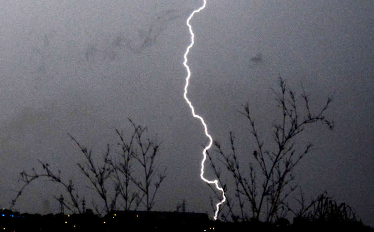 Lightning breaks over the eastern suburbs of Brisbane, Sunday, Nov. 18, 2012. Dangerous thunderstorms with large hailstones have moved through Queensland's southeast corner, with the weather bureau issuing warnings for the region. (AAP Image/Dan Peled) NO ARCHIVING