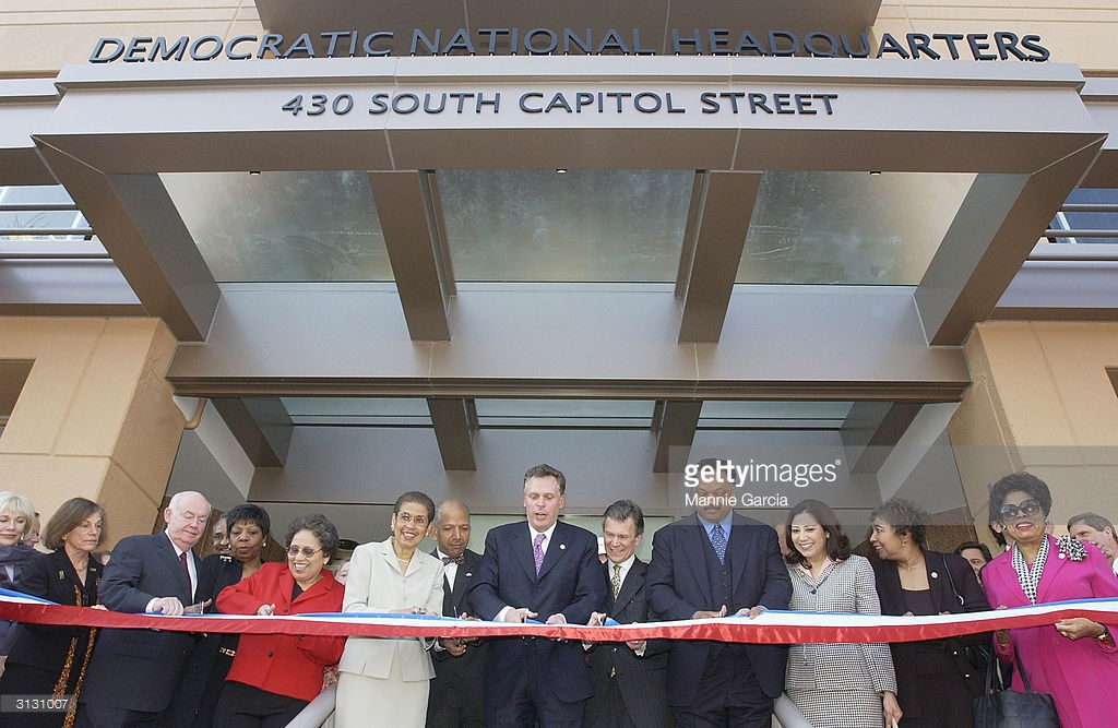 WASHINGTON - MARCH 25: The newly remodled Democratic National Committee building was opened in Washington, D.C. today, March 25, 2004. Dignataries at the ribbon cutting cerimony included DNC Hairman Terry McAuliffe (C), Senator Tom Daschle (D-SD)(R), Reverend Jessy Jackson (2R), Congresswoman Nancy Pelosi (D-CA), Deligate Elinore Holms-Norton (D-DC) (2L), Democratic Govenor of New Mexico Bill Richardson and D.C. Mayor Anothy Williams (L). (Photo by Mannie Garcia/Getty Images)