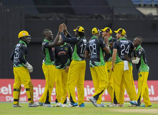 KINGSTON, JAMAICA - JULY 31: Nikita Miller (2L) of Jamaica Tallawahs celebrates the dismissal of Danza Hyatt of Antigua Hawksbills during a match between Jamaica Tallawahs and Antigua Hawksbills as part of the week 4 of Caribbean Premier League 2014 at Sabina Park on July 31, 2014 in Kingston, Jamaica. (Photo by Randy Brooks/LatinContent/Getty Images)