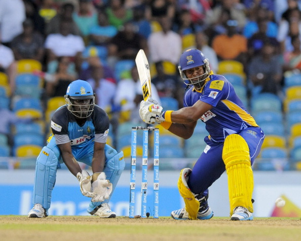 BRIDGETOWN, BARBADOS - JULY 23: Dwayne Smith (R) of Barbados Tridents hits 4 during a match between Barbados Tridents and St. Lucia Zouks as part of the week 3 of Caribbean Premier League 2014 at Kensington Oval on July 23, 2014 in Bridgetown, Barbados. (Photo by Randy Brooks/LatinContent/Getty Images)