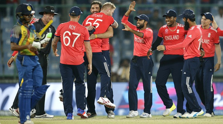 England players celebrate after defeating Sri Lanka by 10 run in their ICC Twenty20 2016 Cricket World Cup match at the Feroz Shah Kotla Cricket Stadium in New Delhi, India, Saturday, March 26, 2016. (AP Photo /Tsering Topgyal)
