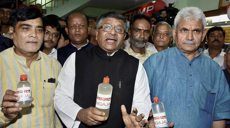 Patna: Communications & IT Minister Ravi Shankar Prasad with Minister of State for Railways and (Independent charge) for Communications Manoj Sinha, MoS Ramkripal Yadav during launch of Gangajal distribution at General Post Master office in Patna on SUnday. PTI Photo (PTI7_10_2016_000148B)