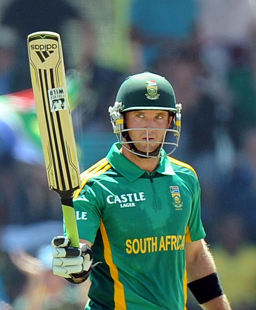 South Africa cricketer Colin Ingram raise his bat after scoring a half century (50 runs) during a One Day International (ODI) cricket match between South Africa and Pakistan in Bloemfontein at Chevrolet Park on March 10, 2013. AFP PHOTO / ALEXANDER JOE        (Photo credit should read ALEXANDER JOE/AFP/Getty Images)