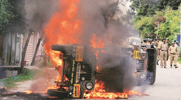 Agartala: A vehicle in flames during a clash between Indigenous People's Front of Tripura (IPFT) and local people following a rally in Agartala on Tuesday. IPFT has been demanding for separate statehood - Tipraland. PTI Photo (PTI8_23_2016_000308A)