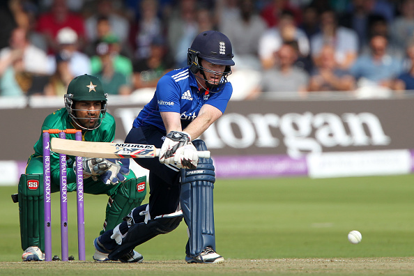 LONDON, ENGLAND - AUGUST 27: Eoin Morgan of England sweeps as Pakistan wicket keeper Sarfraz Ahmed looks on during the 2nd One Day International at Lord's Cricket Ground on August 27, 2016 in London, England. (Photo by Sarah Ansell/Getty Images).