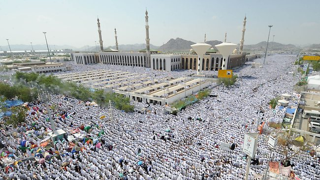 665928-muslim-pilgrims-pray-outside-the-namera-mosque-in-mecca