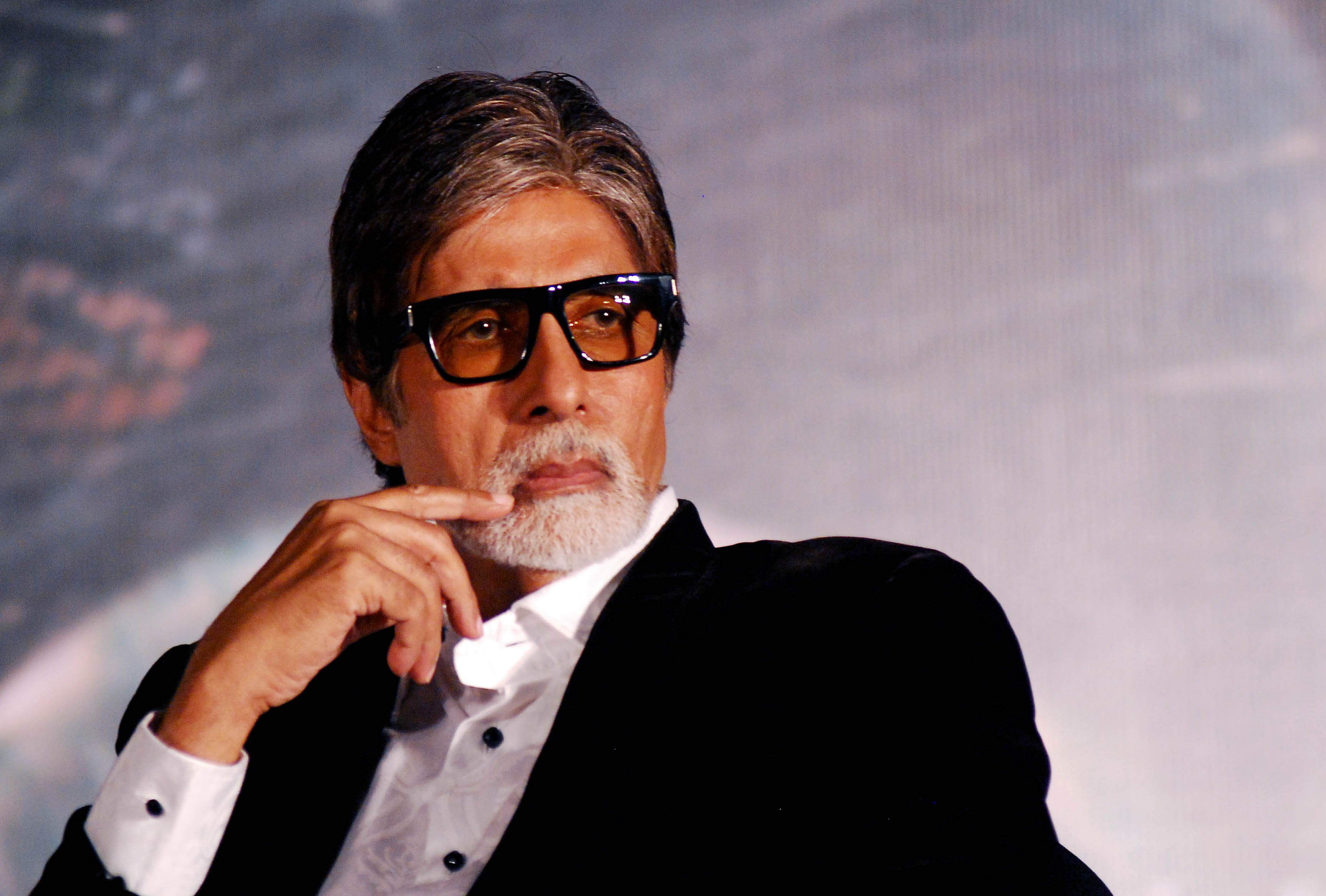 "Indian Bollywood actor Amitabh Bachchan attends a promotional event for the updated ""Raghupati Raghava Raja Ram"" and the upcoming political thriller Hindi film ""Styagraha"" in Mumbai on July 25, 2013. AFP PHOTO/STR"
