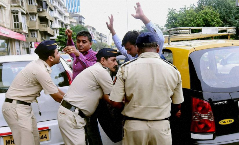 Mumbai: Mumbai police check passengers of a taxi at a checkpost as a high alert was issued by the Naval Quarters after two school children spotted suspicious looking gunmen at Uran, near Mumbai on Thursday. PTI Photo by Santosh Hirlekar (PTI9_22_2016_000232B)