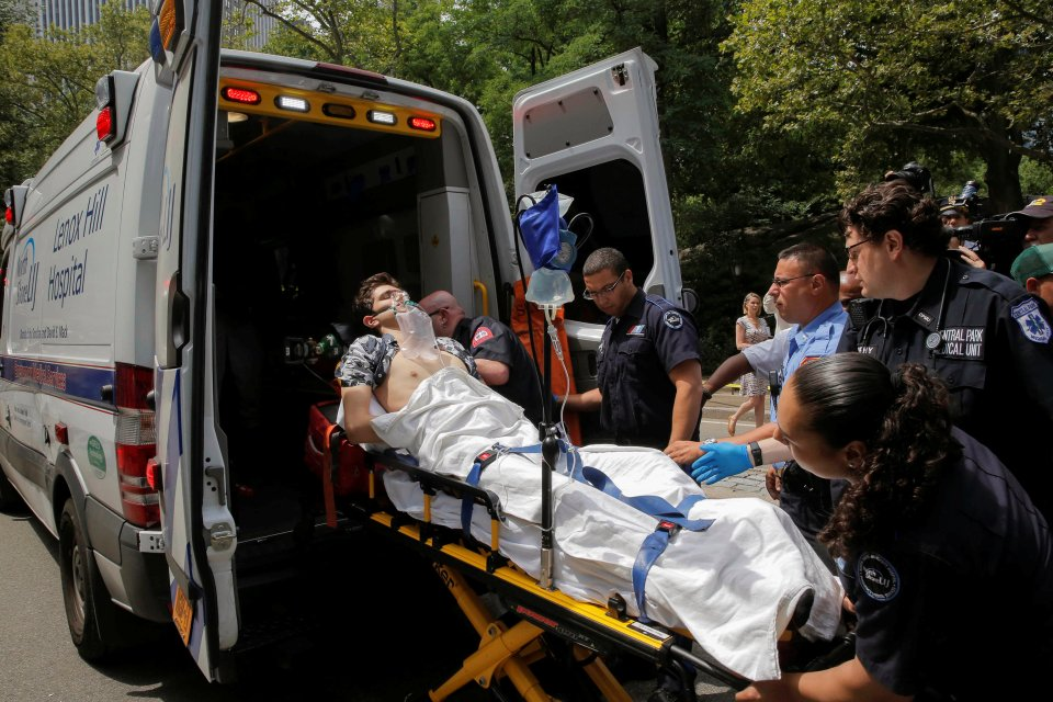 A man is loaded into an ambulance after he was injured after an explosion in Central Park, in Manhattan, New York, U.S. on July 3, 2016. REUTERS/Andrew Kelly