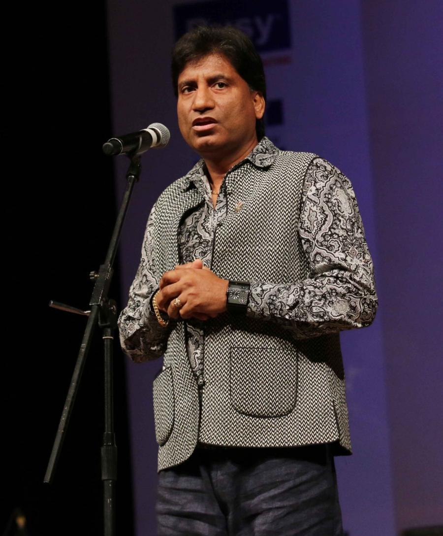 New Delhi: Indian comedian Raju Srivastav performs during a programme organised by PHD Chamber at Siri Fort Auditorium in New Delhi, on March 16, 2016. (Photo: Sunil Majumdar/IANS)