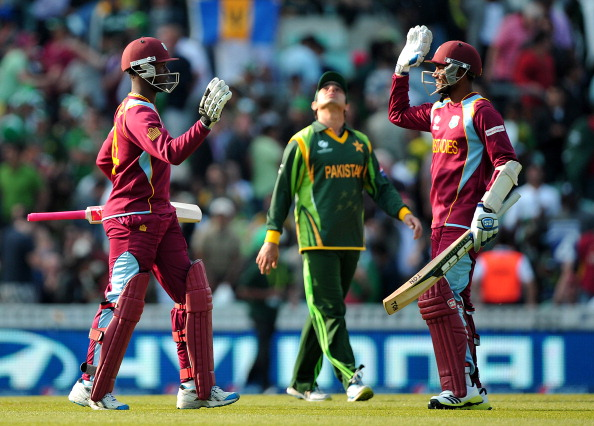 West Indian cricketer Denesh Ramdin (R) and Kemar Roach (L) celebrate after winning the 2013 ICC Champions Trophy cricket match between Pakistan and West Indies at The Oval cricket ground in London on June 7, 2013. AFP PHOTO / CARL COURT  == RESTRICTED TO EDITORIAL USE ==        (Photo credit should read CARL COURT/AFP/Getty Images)