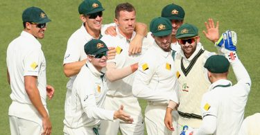 peter-siddle-of-australia-is-congratulated-by-team-mates-after-taking-the-wicket-of-ross-taylor-of-new-zealand-during-day-one-of-the-third-test-match-between-australia-and-new-zeala