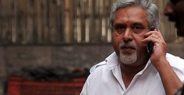 Chairman and CEO of India's Kingfisher Airlines Vijay Mallya talks on his cellphone during a meeting with pilots in New Delhi on March 15, 2012. Chairman of the beleaguered airline Vijay Mallya was scheduled to meet pilots in the Indian capital in an attempt to steer it out of the crisis. India's Kingfisher Airlines earlier curtailed its overseas flights to avoid losing further cash as it struggles to keep flying amid mounting operational difficulties. AFP PHOTO/ Manan VATSYAYANA / AFP / MANAN VATSYAYANA