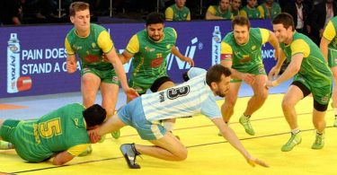 Ahmedabad: Players of Australia Kabaddi Team try to catch a player of Argentina Kabaddi team during Kabaddi World Cup 2016 in Ahmedabad on Wednesday.   PTI Photo (PTI10_12_2016_000264B)