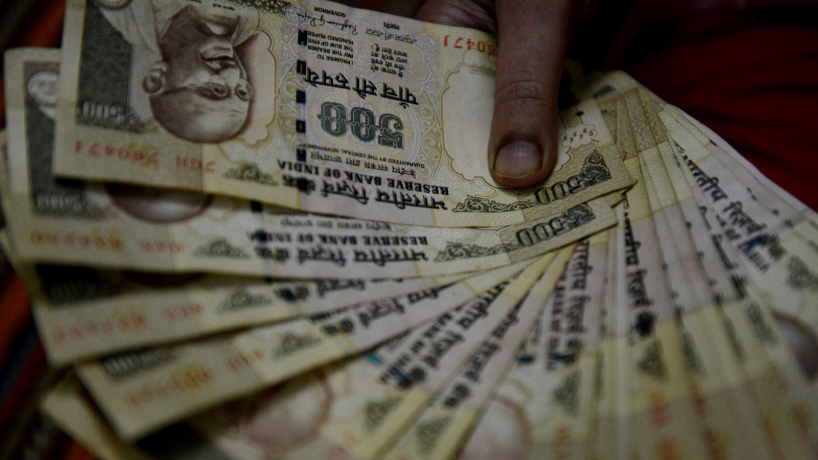 "An Indian woman holds 500 INR currency notes at her home in Faridabad, a suburb of New Delhi, on November 8, 2016.  Indian Prime Minister Narendra Modi announced late November 8 that 500 and 1,000 ($15) rupee notes will be withdrawn from financial circulation from midnight, in a bid to tackle corruption. ""To break the grip of corruption and black money, we have decided that the 500 and 1,000 rupee currency notes presently in use will no longer be legal tender from midnight ie 8 November, 2016,"" Modi said in a special televised address to the nation. / AFP / MONEY SHARMA        (Photo credit should read MONEY SHARMA/AFP/Getty Images)"
