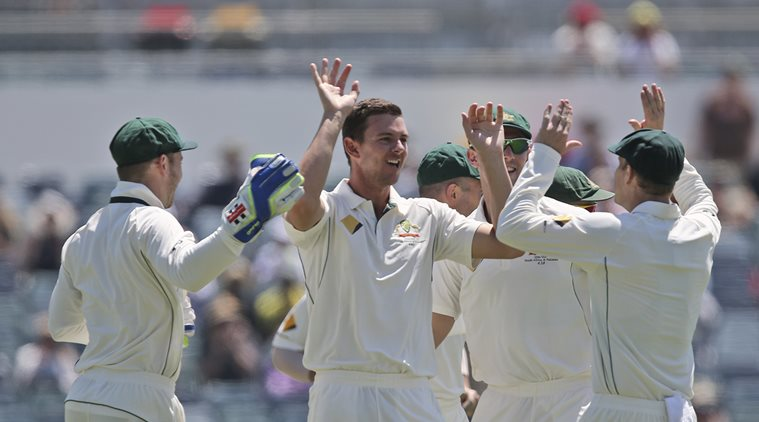Australia's Josh Hazlewood, center, celebrate with his team after taking the wicket of South Africa's Hashim Amla for a duck on the first day of play in their cricket test match against South Africa in Perth, Australia, Thursday, Nov. 3, 2016.(AP Photo/Rob Griffith)