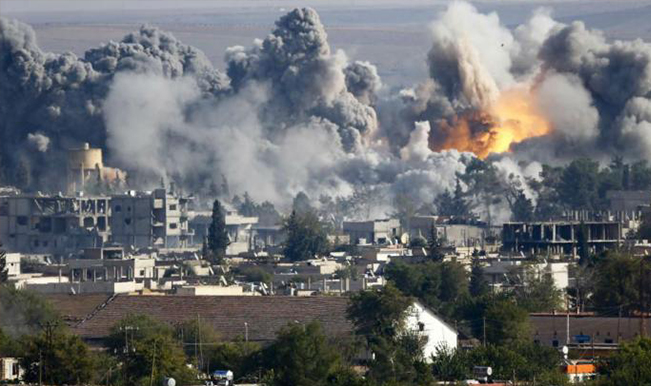 Civilians in ISIS-held Raqa under fire 'from all sides' - Amnesty