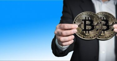 person-holding-Bitcoin-replica