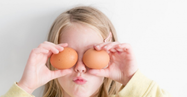 little-girl-holding-eggs