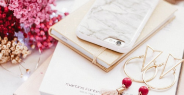 Flower, book, phone and gold earring